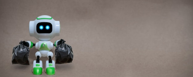 Robô segurar sacos de lixo tecnologia reciclar ambiente sobre um fundo cinza