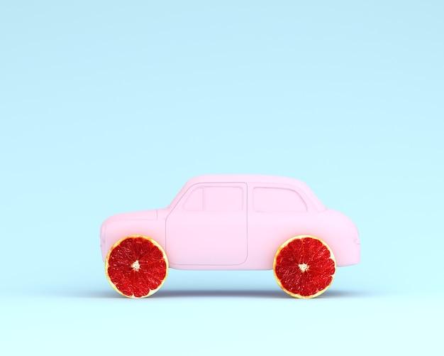 Roda da disposição da toranja e rosa do carro no fundo azul pastel. comida mínima e con fruta