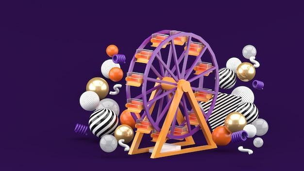 Roda gigante entre bolas coloridas em um espaço roxo