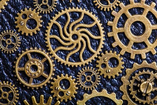 Rodas de engrenagens de engrenagens mecânicas de steampunk em fundo de couro