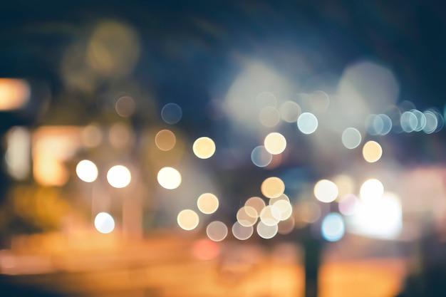Rua da cidade de noite ilumina fundo de bokeh, luzes turva bokeh de fundo