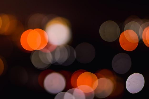 Rua da cidade de noite ilumina o fundo de bokeh, luzes turva bokeh de fundo