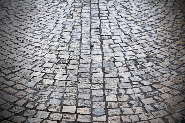 Rua de paralelepípedos velha fundo textura escura vinheta