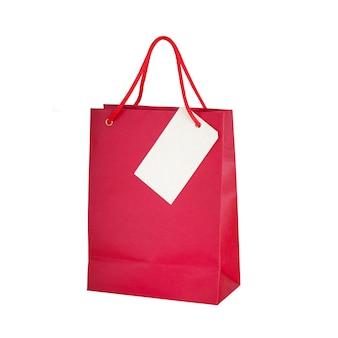 Saco de compras com nota de papel post it, isolado