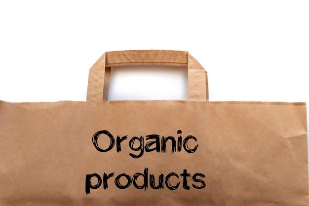Saco de papel artesanal marrom para embalagem de alimentos em fundo branco com a inscrição produtos orgânicos