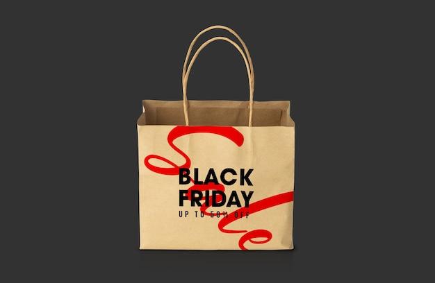 Saco de papel kraft marrom reciclado com modelo de maquete de campanha de sexta-feira preta para seu projeto.