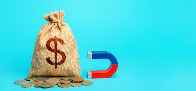 Saco e ímã de dinheiro do dólar. captação de recursos e investimentos em projetos de negócios e startups