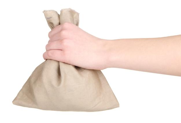 Saco pequeno na mão, isolado no branco