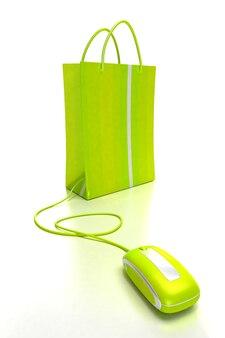 Sacola de compras verde conectada a um mouse de computador