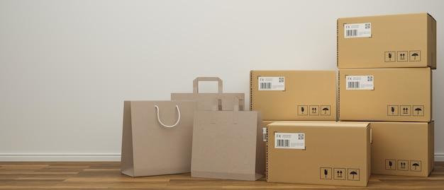 Sacos de compras e caixas de papelão empilhados no chão de madeira com fundo branco na parede