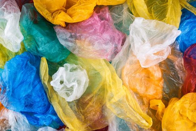 Sacos de plástico embrulhados multicoloridos textura de fundo