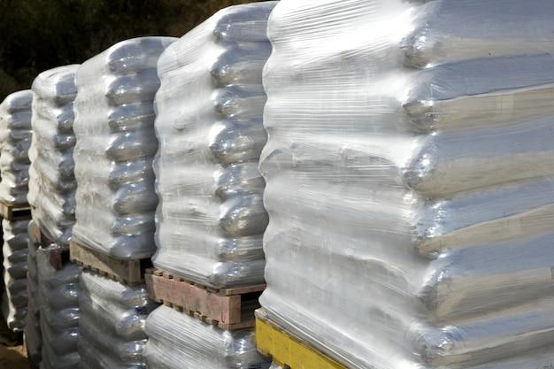 Sacos de sacos de areia sacos de paletes de madeira branca