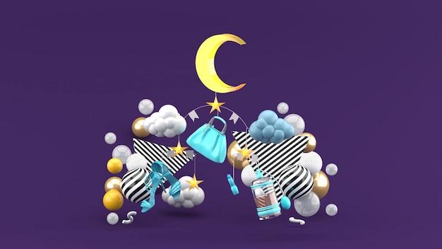 Sacos móveis, sapatos, lua e estrelas em meio a bolas coloridas em um espaço roxo