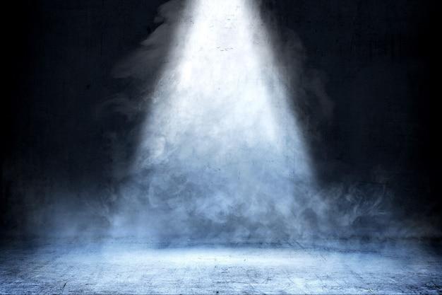 Sala com piso de concreto e fumaça com luz de cima, fundo