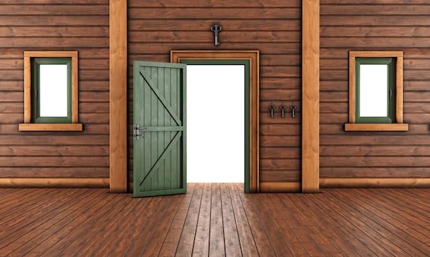 Sala de entrada vazia de uma casa de madeira com porta aberta