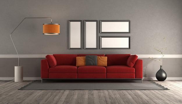 Sala de estar com sofá vermelho moderno, moldura vazia e luminária de chão - renderização em 3d