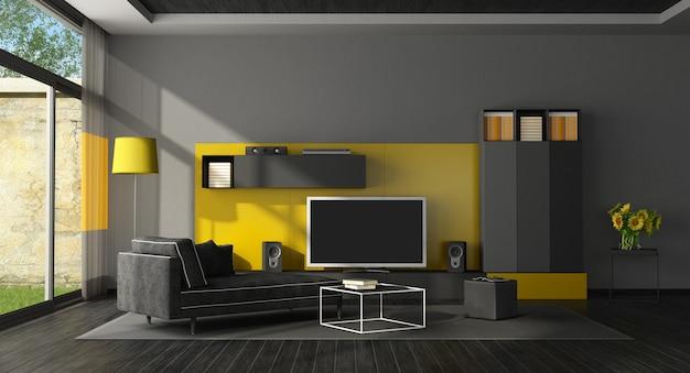 Sala de estar preta e amarela com aparelho de tv