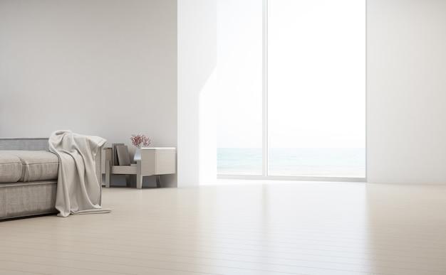 Sala de estar vista mar da casa de praia de verão luxo com janela de vidro e piso de madeira.