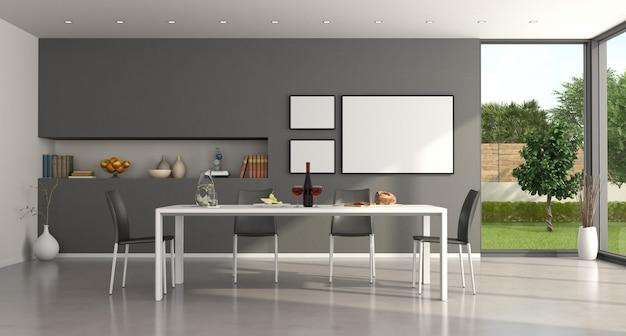 Sala de jantar minimalista branca e cinza