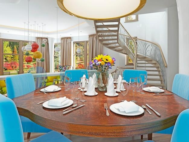 Sala de jantar moderna com cozinha e mesa de jantar redonda com confortável