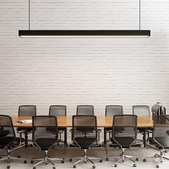Sala de reuniões com cadeiras em frente à parede de tijolos brancos