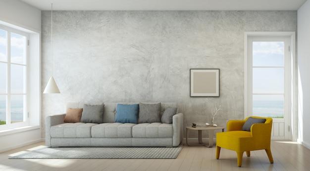 Sala de visitas da opinião do mar com o muro de cimento na casa de praia moderna.