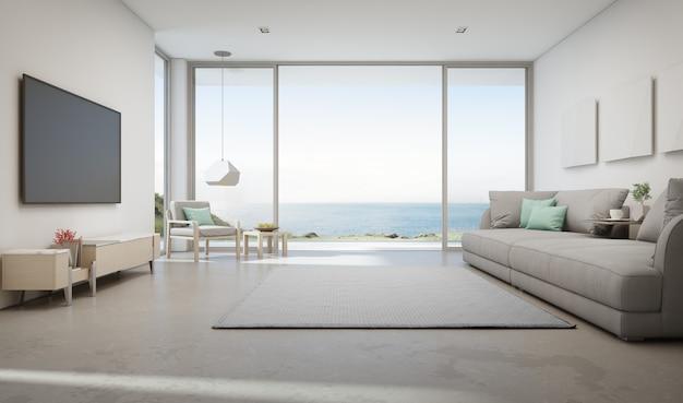 Sala de visitas da opinião do mar da casa de praia luxuosa do verão com a grande porta de vidro e o terraço de madeira.