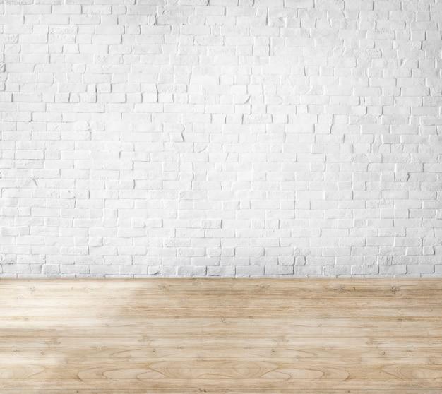 Sala feita de parede de tijolos e piso de madeira