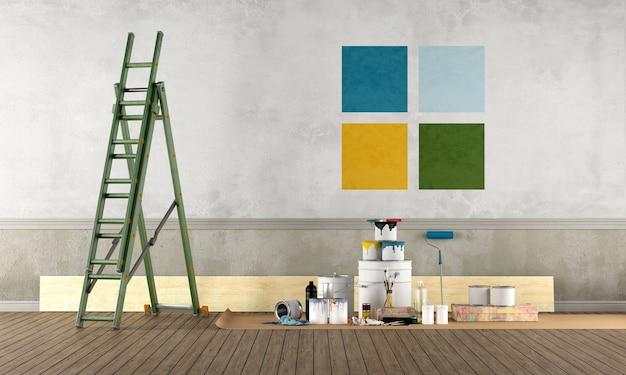 Sala vazia com equipamento de pintura