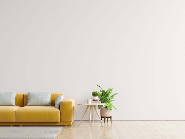 Sala vazia com sofá amarelo, plantas e mesa no fundo da parede branca vazia.