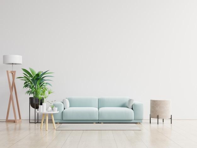 Sala vazia com sofá azul, plantas e mesa no fundo da parede branca vazia.