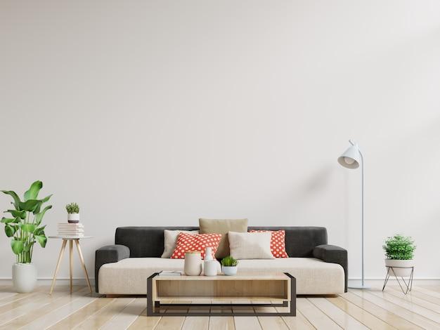 Sala vazia com sofá, lâmpada, plantas e mesa