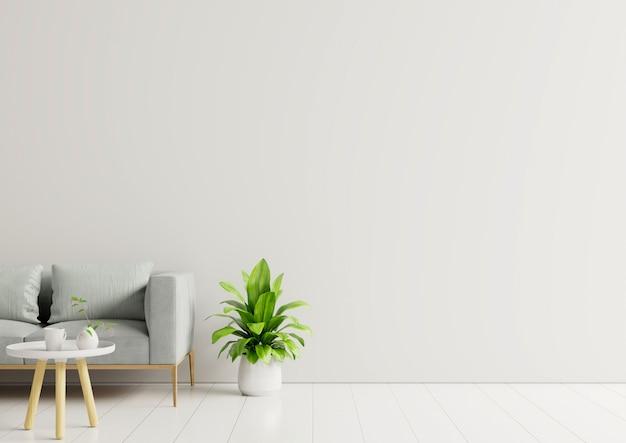 Sala vazia com sofá, plantas e mesa na parede branca vazia