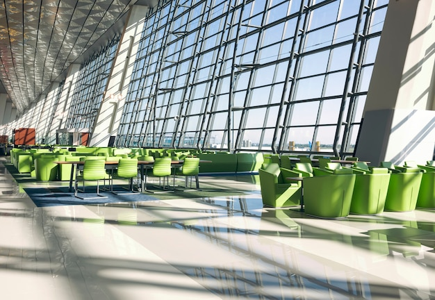 Salão de embarque com sofá e mesa verde