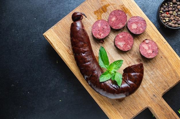 Salsicha morcela comida gorda sangrenta na mesa refeição saudável lanche cópia espaço comida fundo