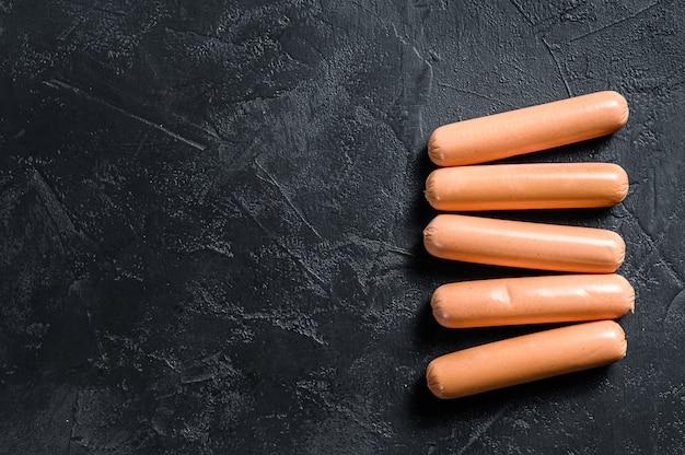 Salsichas de porco de carne cozida clássico.