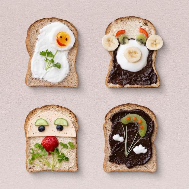 Sanduíches de arte culinária infantil, com rostos engraçados e flores