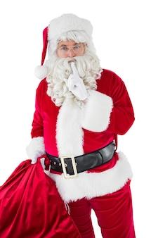 Santa segurando seu saco e mantendo um segredo