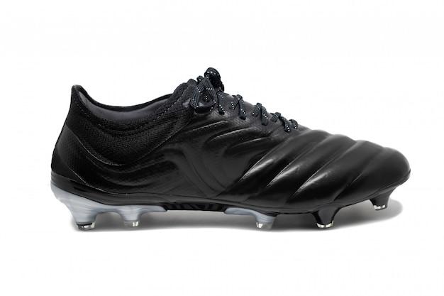 Sapatos de futebol isolado no fundo branco