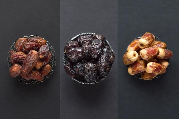 Saudita datas frutas são dispostas em uma mesa escura.