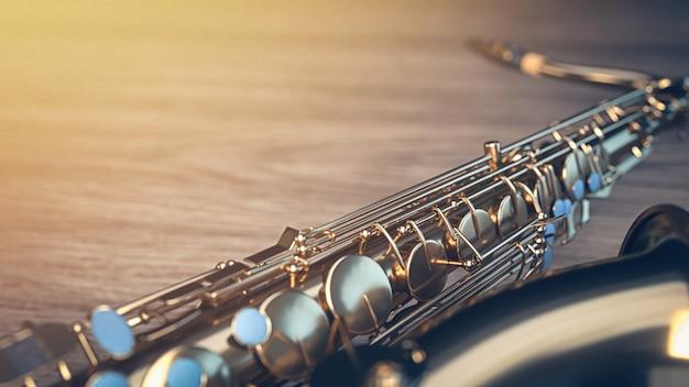 Saxofone repousa sobre piso de madeira.