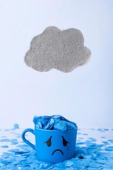 Segunda-feira azul com caneca lacrimosa e nuvem