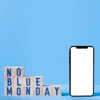 Segunda-feira azul com cubos de madeira e smartphone