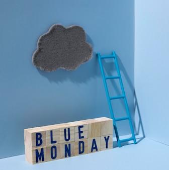 Segunda-feira azul com nuvem e cubos de madeira
