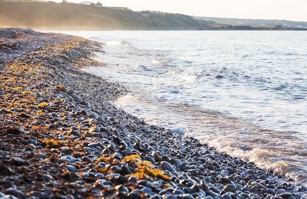 Seixo na praia do nascer do sol