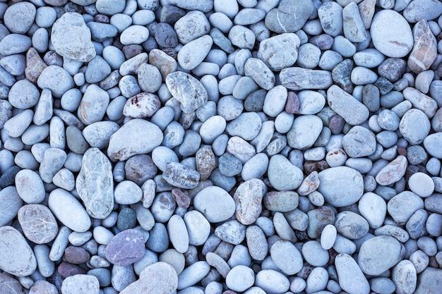 Seixos cinzentos na praia