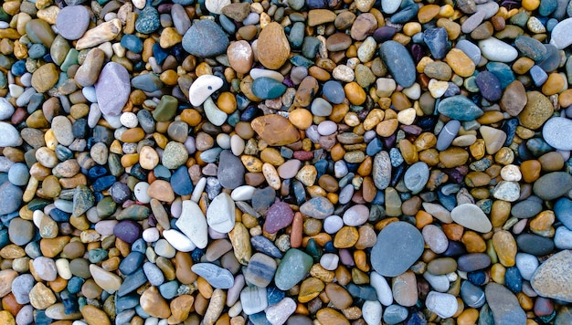 Seixos em uma praia, fundo de pedras