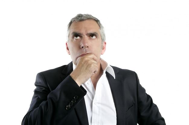 Sênior, pensando, homem negócios, mão, em, rosto, cabelo cinzento