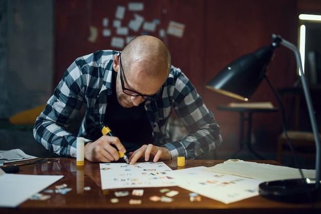 Sequestrador maníaco mãos cortando letras