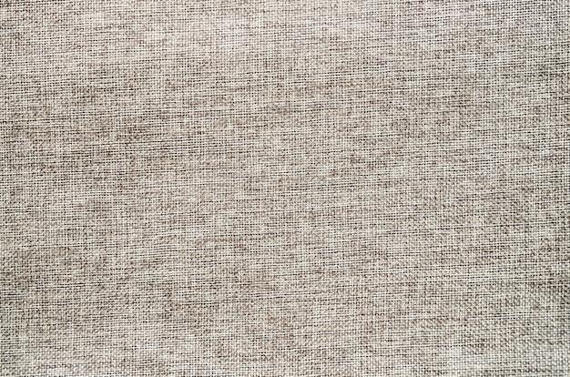 Serapilheira texturizada de fundo. textura de pano de saco de lona.
